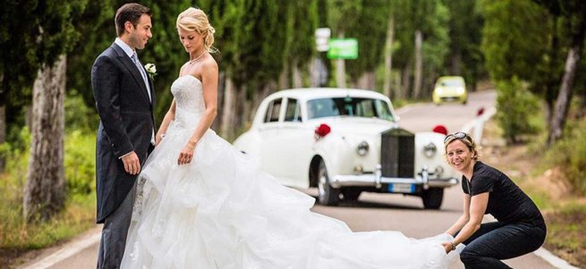 Wedding Planner Holding a wedding dress train   Kelly Chandler Consulting