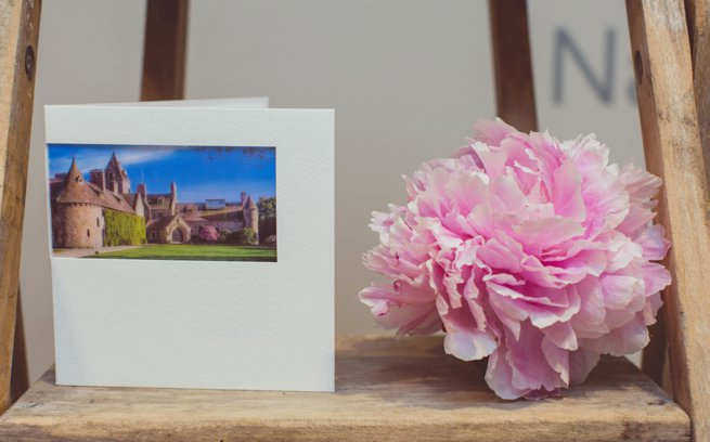 Photo of St Ouens Manor printed on a white invitation | Kelly Chandler Consulting