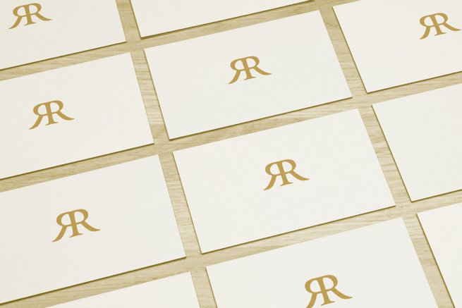 White card with gold monogram | Kelly Chandler Consulting