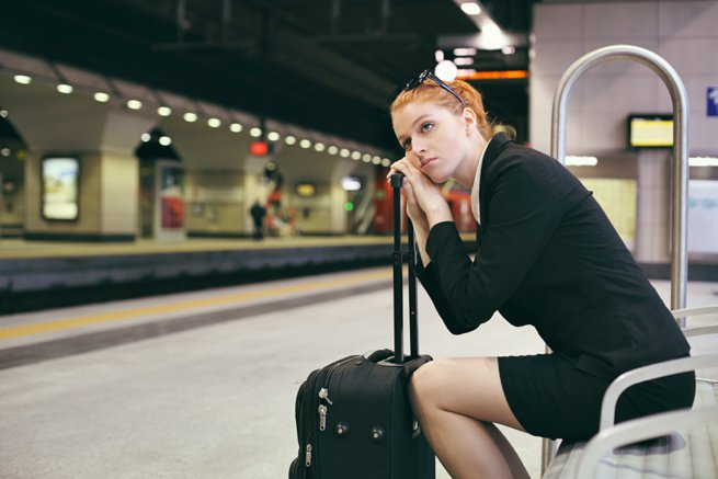 Lady sitting waiting for the tube | Kelly Chanlder Consulting