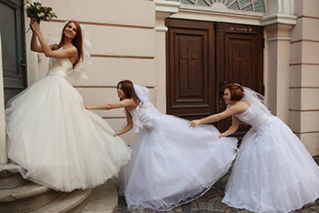 Three brides pulling each others dresses | Kelly Chandler Consulting
