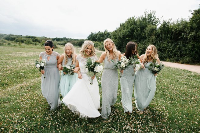Bride and bridesmaids walking and laughing | Kelly Chandler Consulting