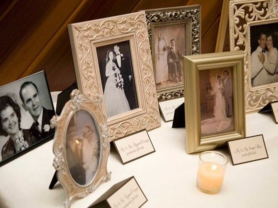Table of old framed wedding photos   Kelly Chandler Consulting