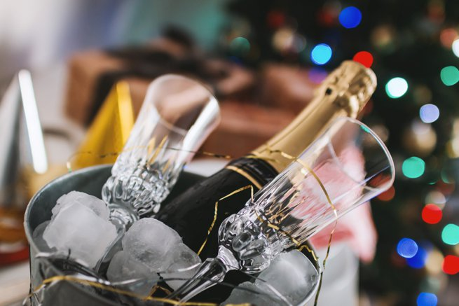 Champagne and glasses in an ice bucket   Kelly Chandler Consulting
