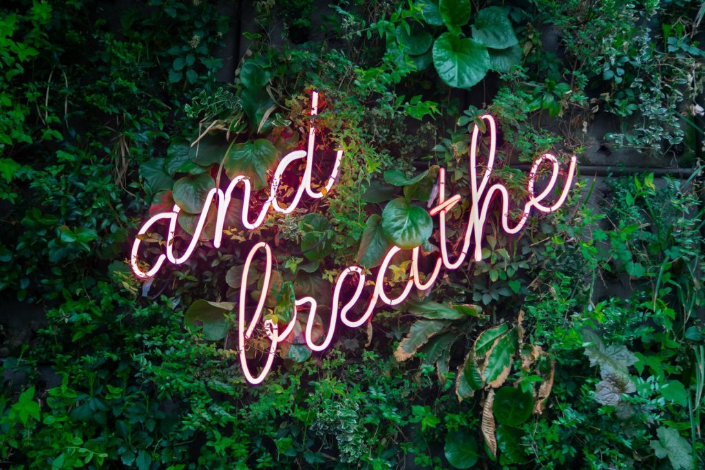 'And Breathe' neon light | Kelly Chandler Consulting