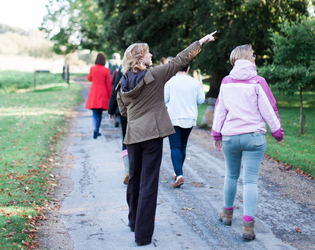 Woman on a leisurely walk pointing at Warmwell House