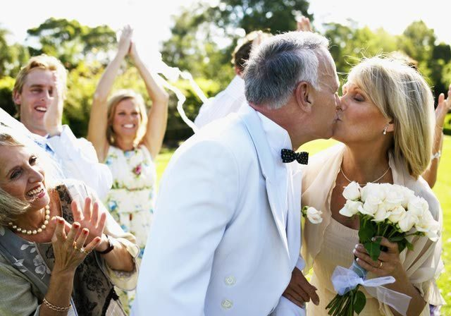Older couple getting married and kissing   Kelly Chandler Consulting