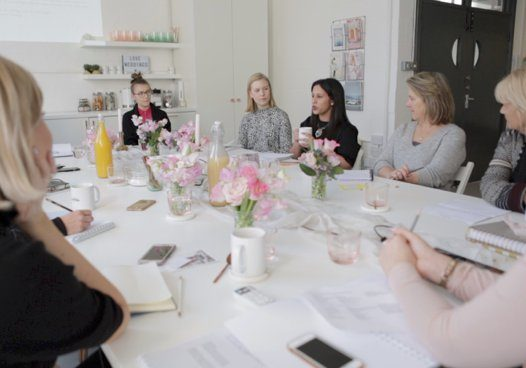 Ladies sitting around a table for a casual business meeting   Kelly Chandler Consulting