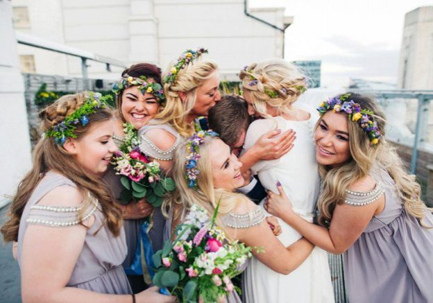 Bride and bridesmaids hugging | Kelly Chandler Consulting