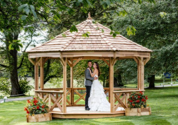 Bride and groom under a gazebo | Kelly Chandler Consulting