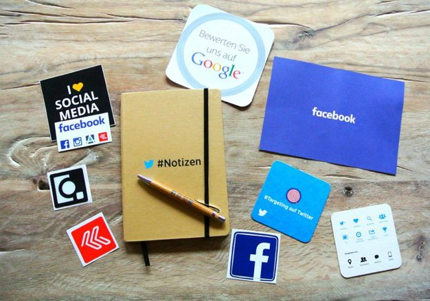Flat lay image of journal and social media icons | Kelly Chandler Consulting