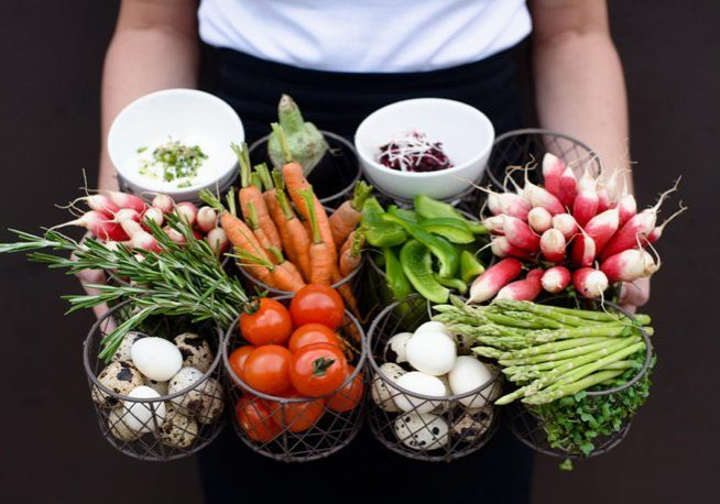 Vibrant fresh vegetable produce being held on a tray | Kelly Chandler Consulting