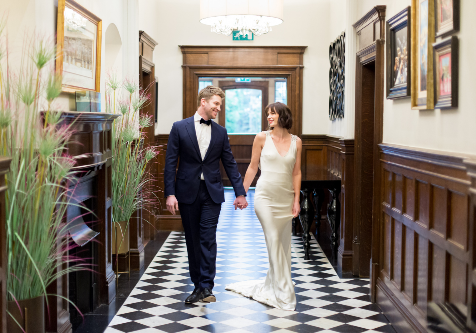 bride and groom walking in a country house turned wedding venue